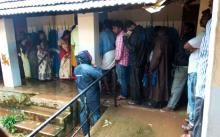 Voters turned up in rain coats on account copious rains in Thiruvananthapuram