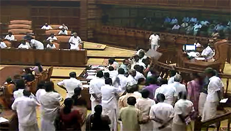 Chief Minister Oommen Chandy winding up debate on the Budget as Opposition protests on Feb. 18