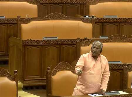 BJP member O. Rajagopal joints the walkout as the last person to leave the House